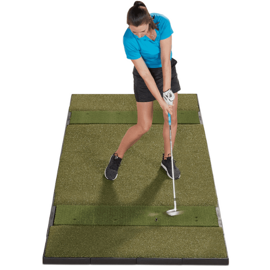 hitting a golf ball off of the fiberbuilt 4 x 10 golf mat