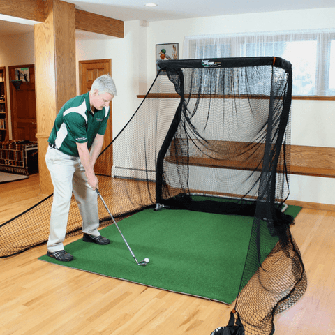 hitting-golf-ball-into-mini-pro-series-net