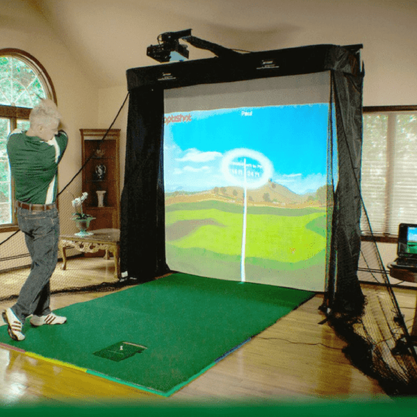 man with the net return simulator series golf net and optishot simulator