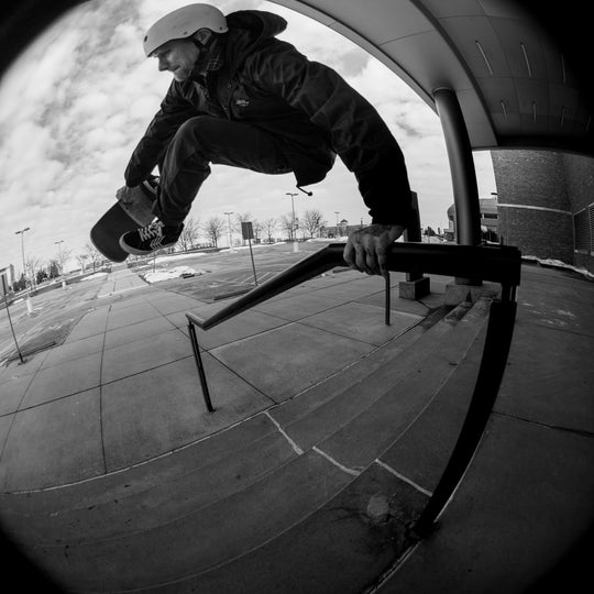 Pro Skateboarder Mike Vallely skating a handrail.