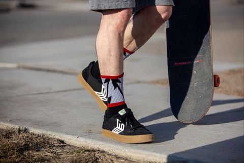 Mike Vallely wearings shorts with SOCCO socks with Cariuma Shoes