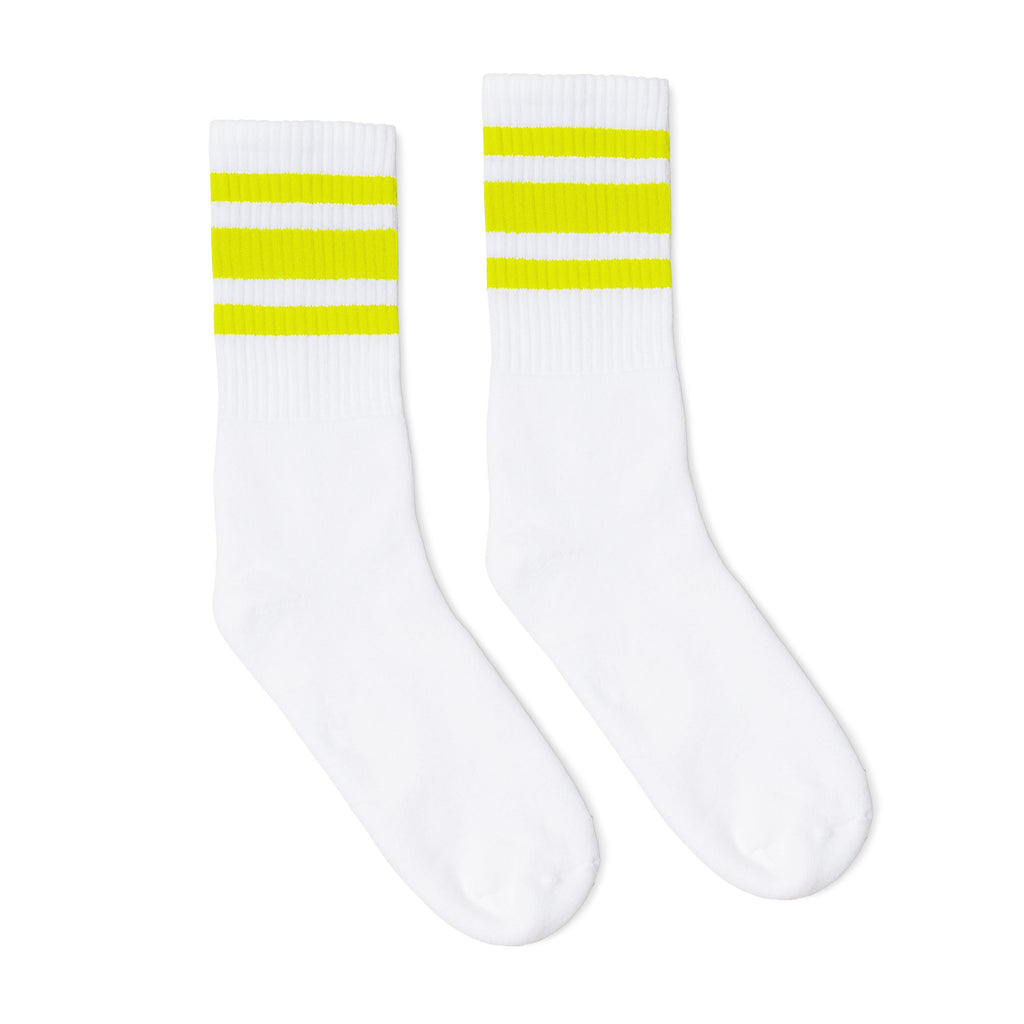 White athletic socks with neon yellow stripes for safety.