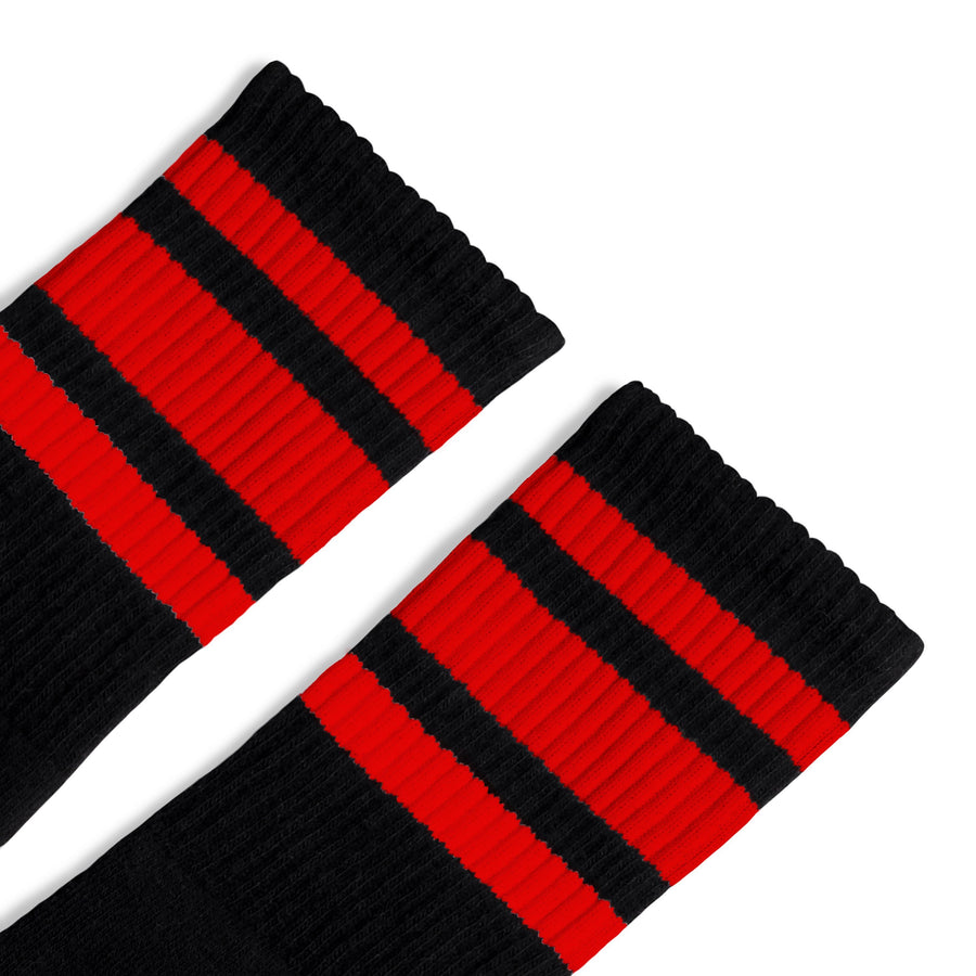 Black athletic socks with three red stripes for men, women and kids.
