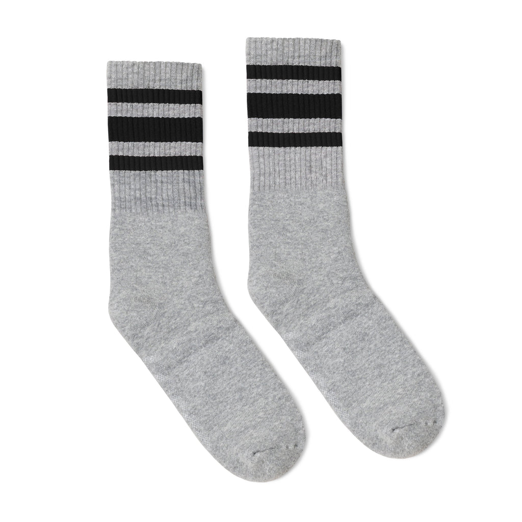 Grey athletic socks with black stripes for men, women and children.