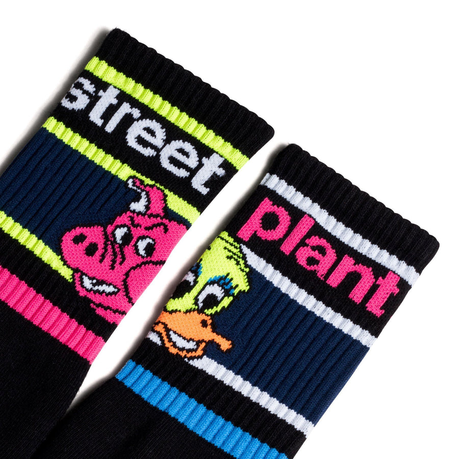 Black socks with a pink and yellow Street Plant Logo and duck head and a pig head.