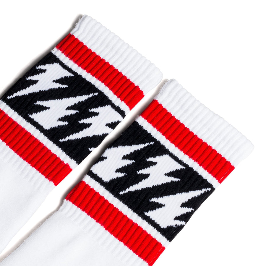 White Mike Vallely lightning bolt socks with two red stripes and alternating white and black lightning bolts for men, women and children.