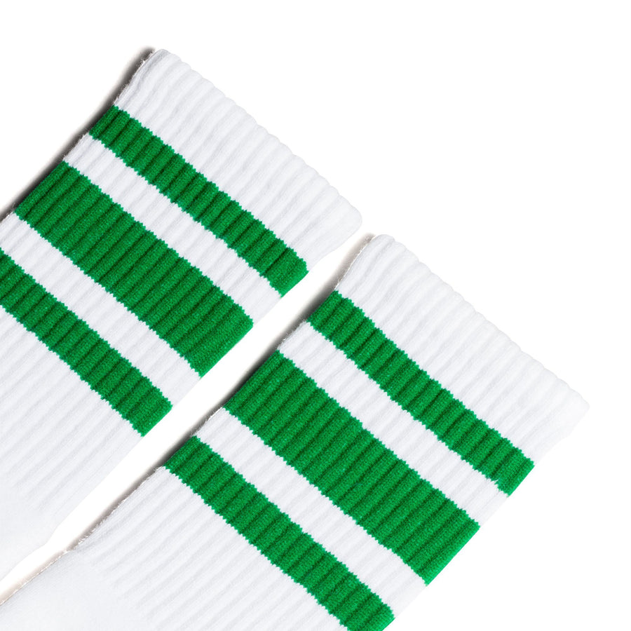 White athletic socks with three green stripes for men, women and children.