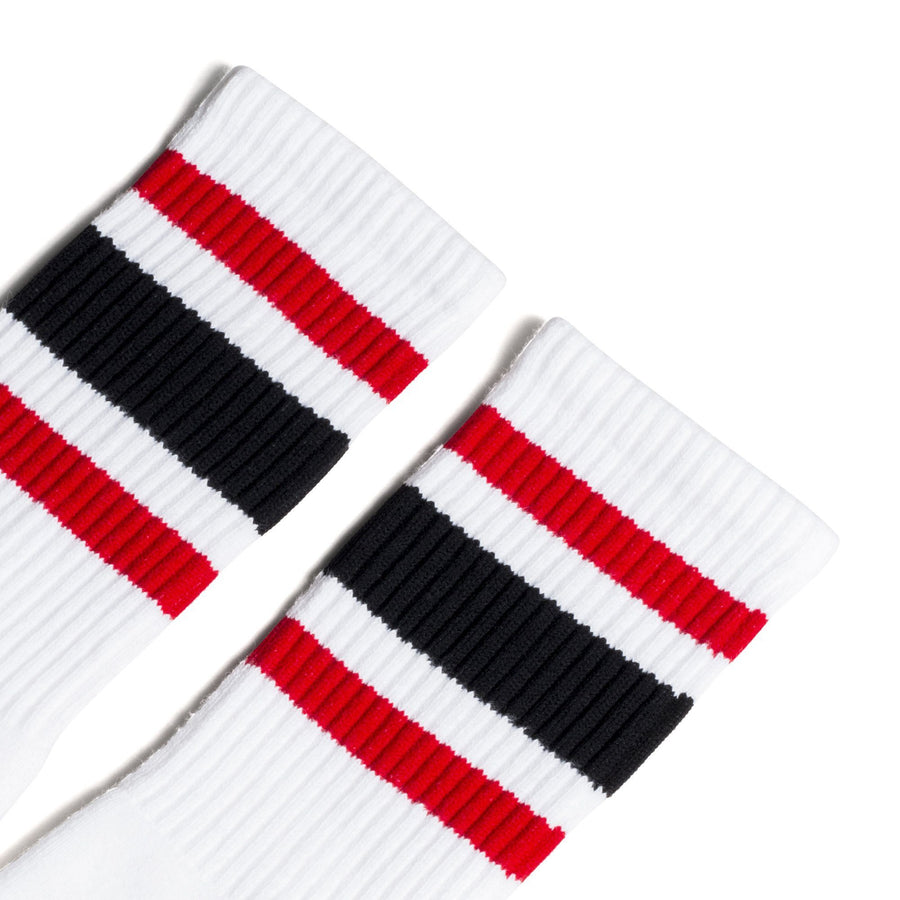 White athletic socks with black and red stripes for men, women and children.