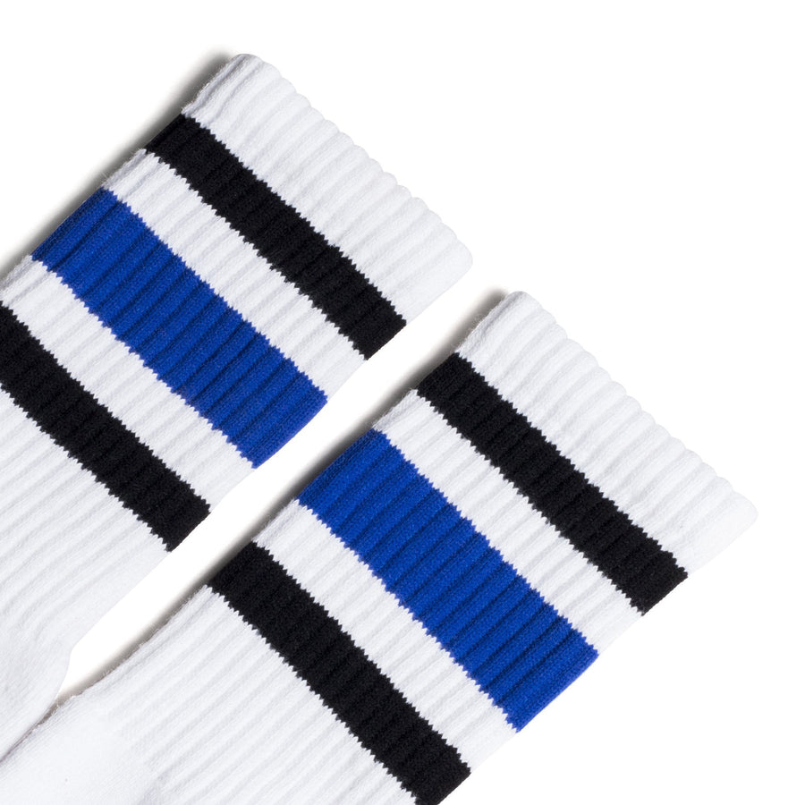 White athletic socks with black and blue stripes for men, women and children.