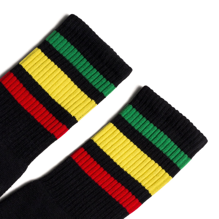 Black athletic socks with one red, green and yellow stripe for men, women and kids.