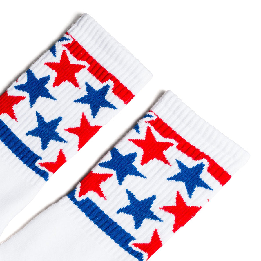 White athletic crew socks with red and blue stars for men, women and kids.