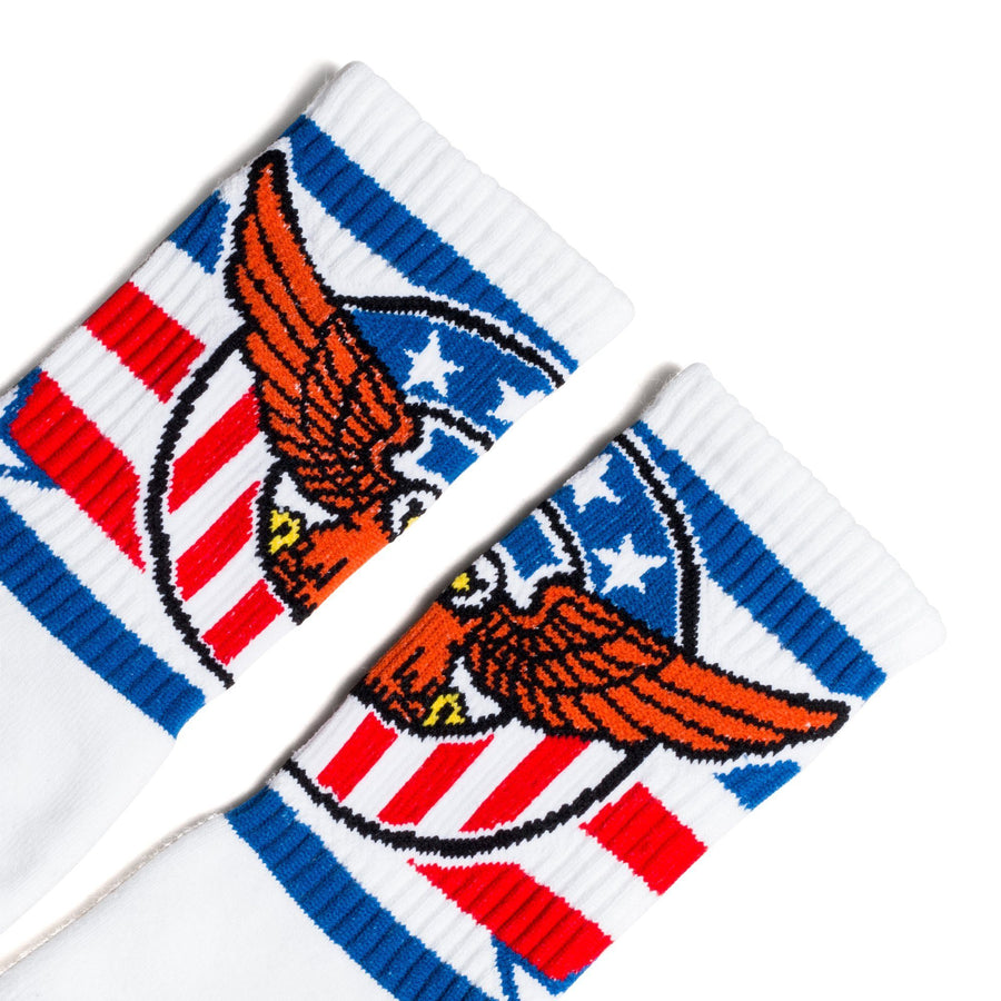 White crew socks with red, white and blue stripes and an eagle for men, women and children.