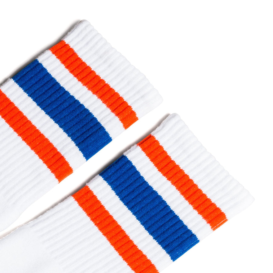 White athletic socks with orange and blue stripes for men, women and kids.
