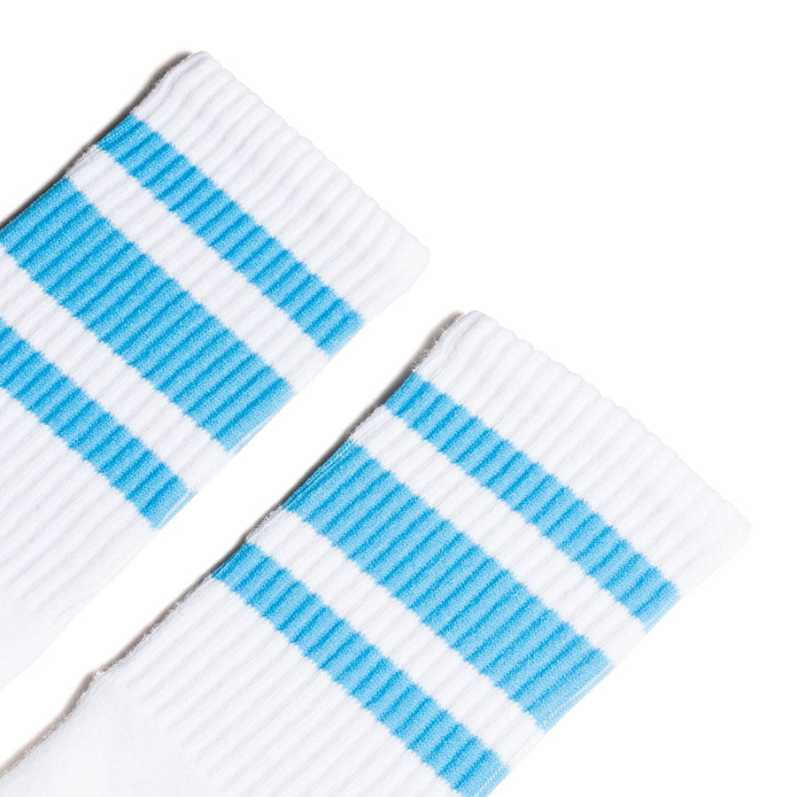 White athletic socks with three Carolina blue stripes for men, women and kids.