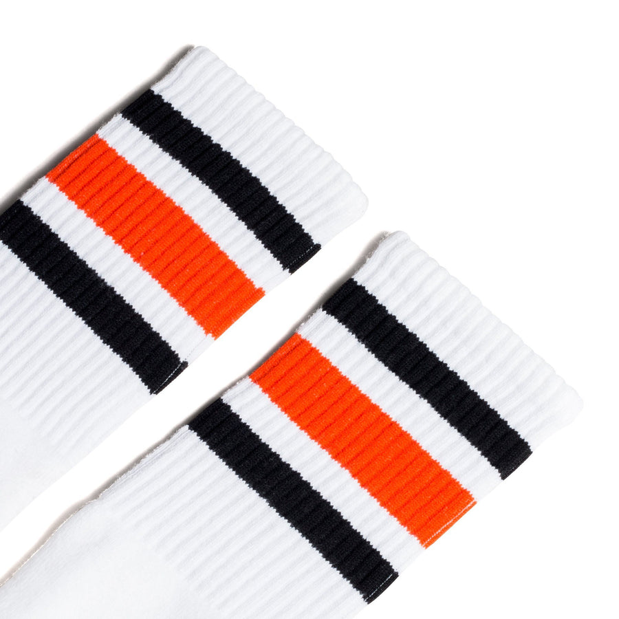 White athletic socks with black and orange stripes for men, women and children