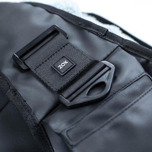 Close up detailed product photo showing where you can attach a closure strap to as well as the phone pocket