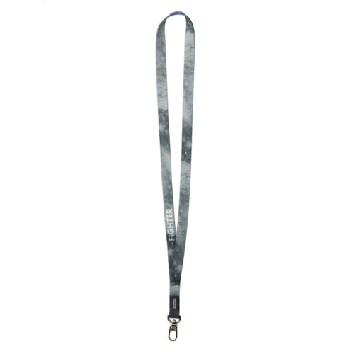 A product image of a ZOX lanyard showing the back of the design with a gold colored metal clip. The lanyard is called Fighter and the design is a greyscale version of the front design which is a space nebula image