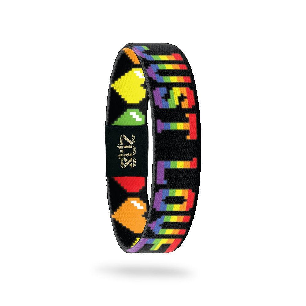 Inside Design of Just Love: black background with rainbow 8-bit text 'Just Love'