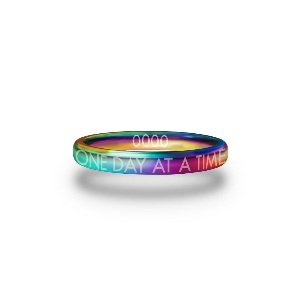 Front design of One Day At A Time multicolor ring with sketched in text 'One Day At A Time'