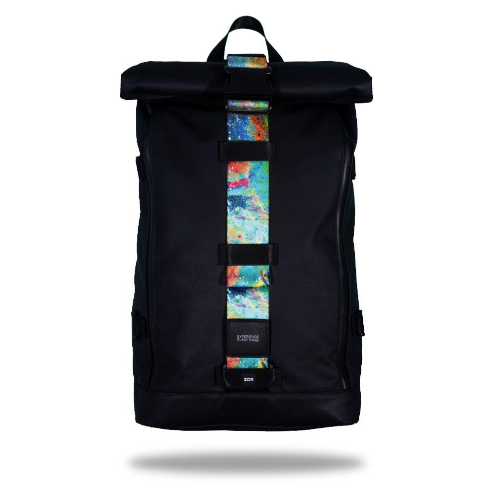 Product image of an Imperial backpack showing a wide strap down the center of it that is interchangeable. The closure strap the item that is for sale on this page and is called I Got This and is a paint splatter design that has colors such as different hues of blues, greens, reds, and oranges