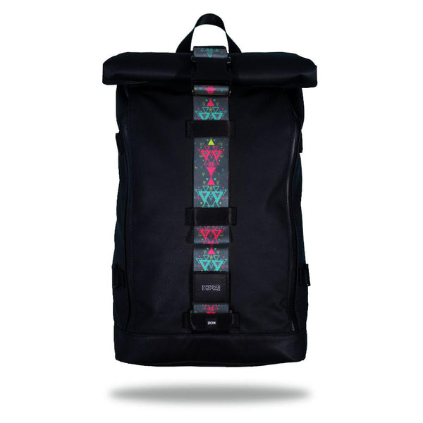 Product image of an Imperial backpack showing a wide strap down the center of it that is interchangeable. The closure strap the item that is for sale on this page and is called Loyal and is a pale blue with pink and lighter blue geometric designs layered on top of it