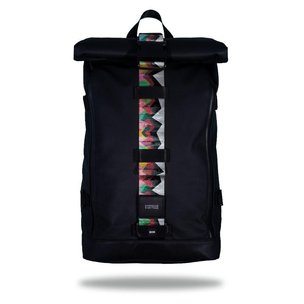 Product image of an Imperial backpack showing a wide strap down the center of it that is interchangeable. The closure strap the item that is for sale on this page and is called Mountains To Molehills and is a geometric mountain range made by triangles in many different colors such as blue, green, orange, and pink