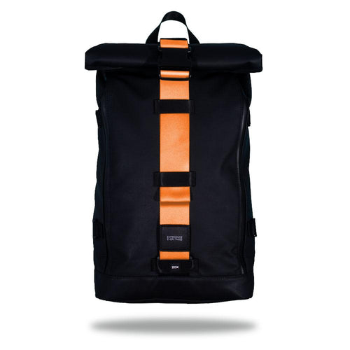 Product image of an Imperial backpack showing a wide strap down the center of it that is interchangeable. The closure strap the item that is for sale on this page and is called Sweet Sunburst and is a solid light orange color