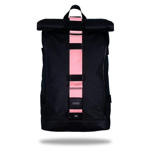 Product image of an Imperial backpack showing a wide strap down the center of it that is interchangeable. The closure strap the item that is for sale on this page and is called Passion Pink and is a solid light pink color