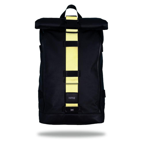 Product image of an Imperial backpack showing a wide strap down the center of it that is interchangeable. The closure strap the item that is for sale on this page and is called Canary Yellow and the design is a solid light yellow color
