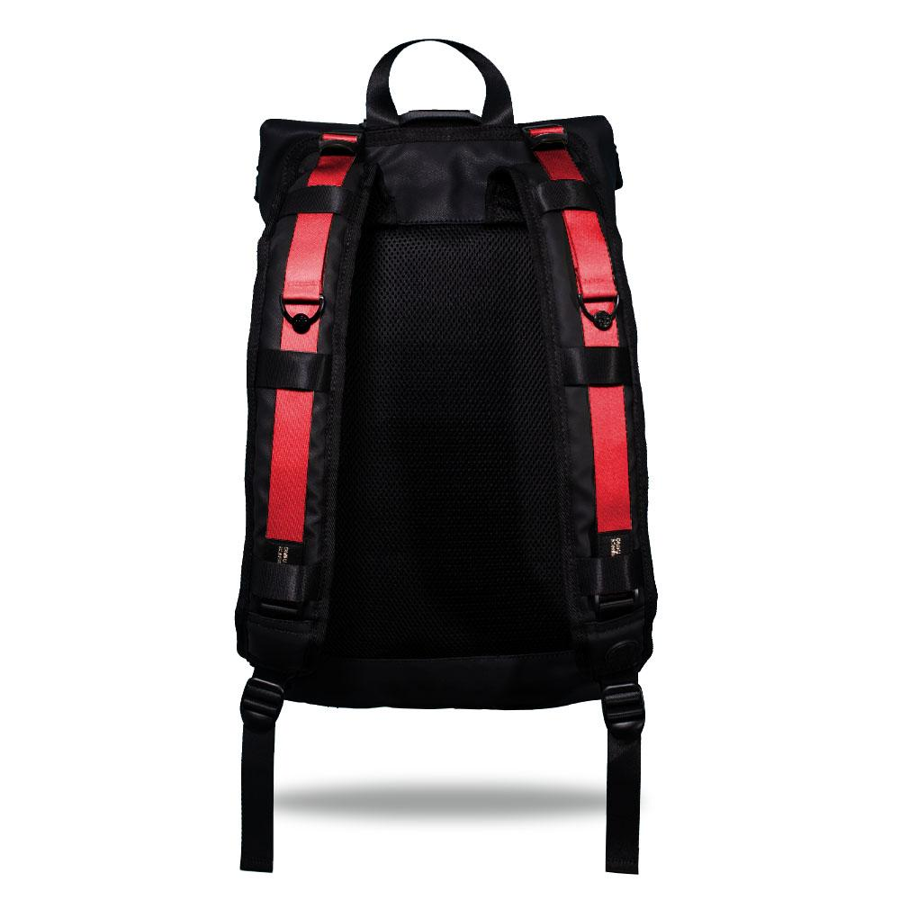 Product image show the back of an Imperial backpack with  two should straps showing with interchangeable straps. The tension strap the item that is for sale on this page and is called Grapefruit and is a solid red orange color
