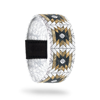 Outside design of Love Who You Are. Geometric repeating pattern with the colors white, yellow-gold, and black.