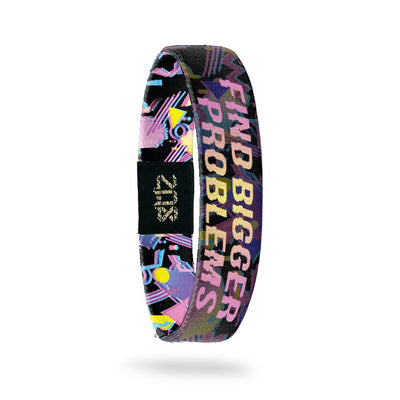 Product photo of inside design with bold text find bigger problems in a pink to yellow gradient with transparent neon geometric designs overlaying a black background