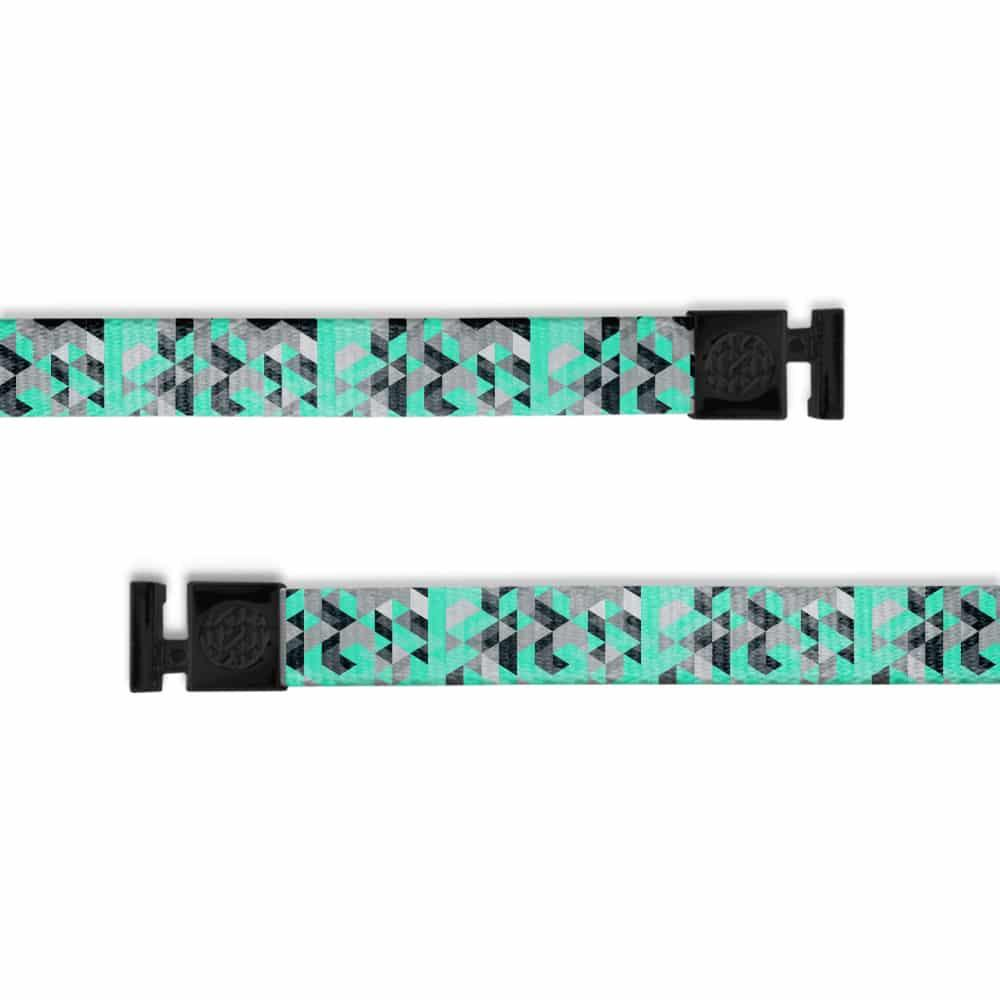 A product image of a wide and flat string with black metal aglets meant to be used with the ZOX hoodie. The string is called Alpha and is a white black and light green geometric pattern