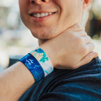 Lifestyle close up image of model's wrist wearing 2 Aquarius straps