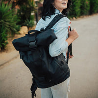 lifestyle photo of the Imperial v2 with a different the standard black tension and closure straps on a woman's shoulder while she smiles during a walk