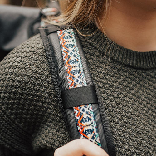 lifestyle photo of the Imperial v2 with a different colored tension strap on a woman's shoulders