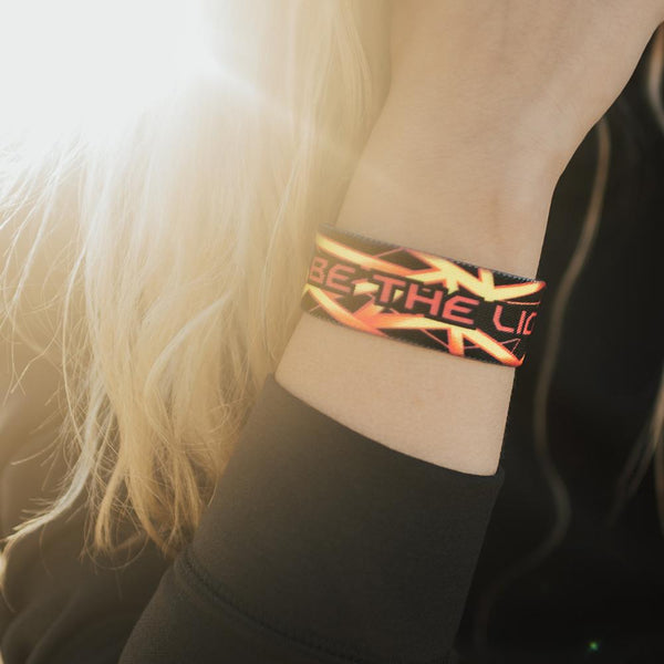 Lifestyle close up image of Be The Light on someone's wrist