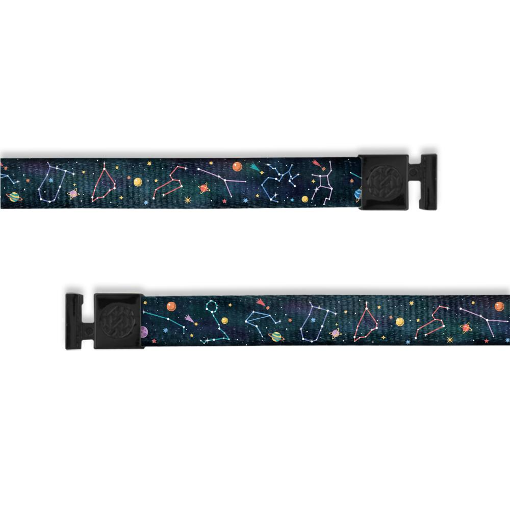 A product image of a wide and flat string with black metal aglets meant to be used with the ZOX hoodie. The string is called Constellations and is a design of the solar system showing the constellations. It is a dark blue watercolor background with little imagery of planets on the front as well as stars with outlines of the constellations.