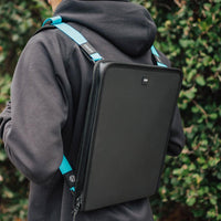 Lifestyle image of a man wearing a document holder with two shoulder straps connected to it