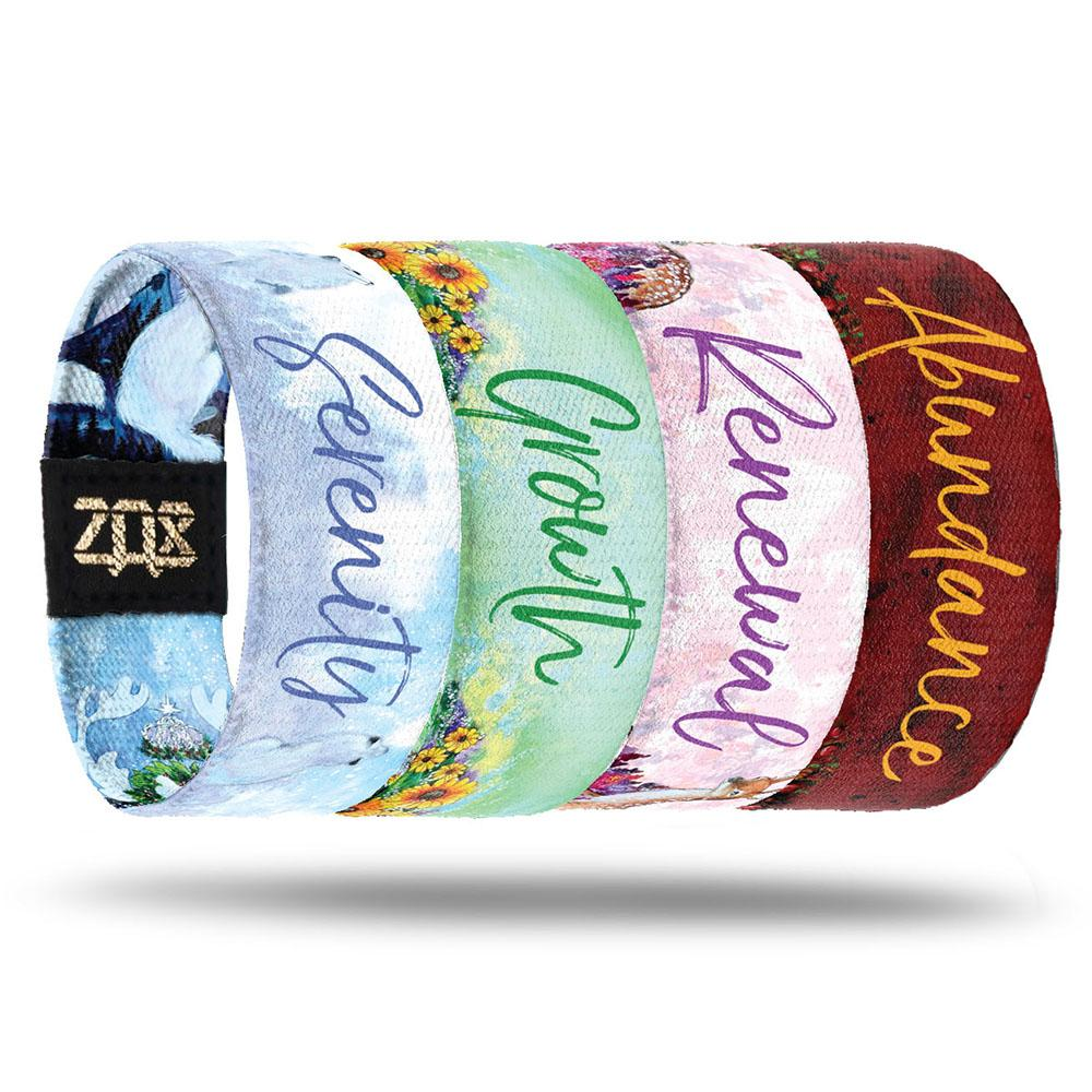 Inside designs of the four wristbands included in the Fairies Pack. From left to right. Light blue background with Serenity in dark blue text. Light green background with a few bundles of sunflowers on the bottom with Growth in dark green text. Light pink background with Renewal in dark pink text. Red background with Abundance in yellow text. All text is centered to each design.