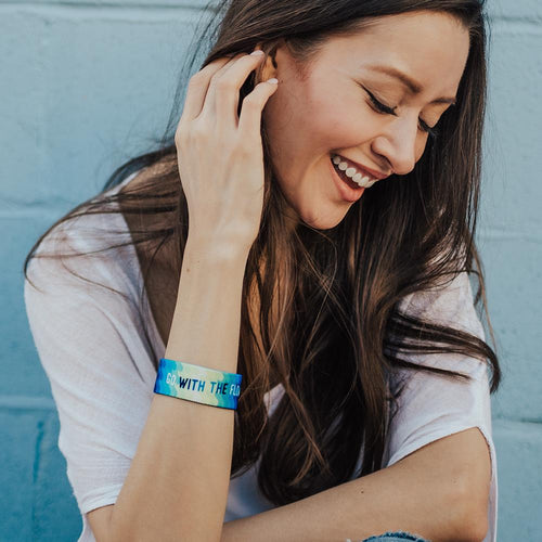 Lifestyle image of women fixing their hair with a Go With The Flow on their wrist
