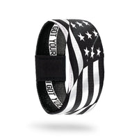 Outside Design of I Got Your Six. wavy black and white United States flag
