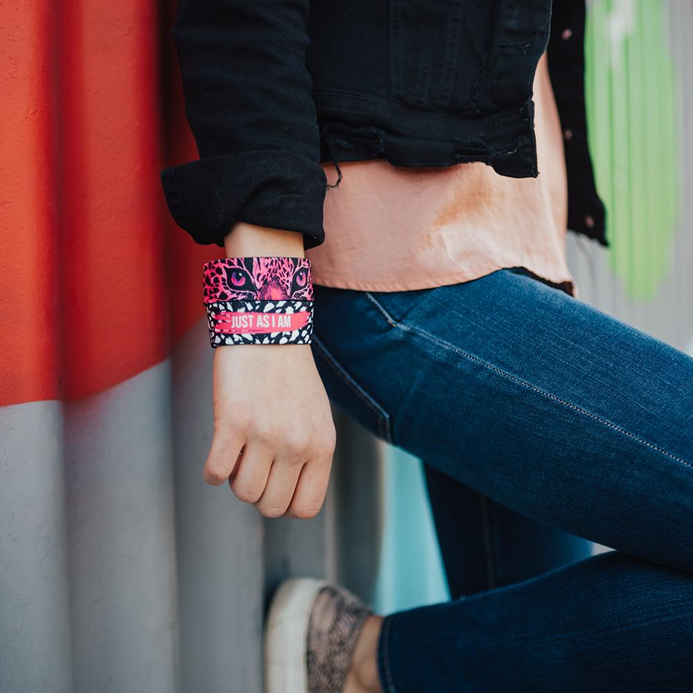 lifestyle image of a woman with her hand to her side with two Just As I Am on, both showing different the pink color variant of the front and back