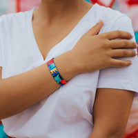 Lifestyle photo of wrist wearing live with joy showing the outside design with hand drawn geometric and abstract art