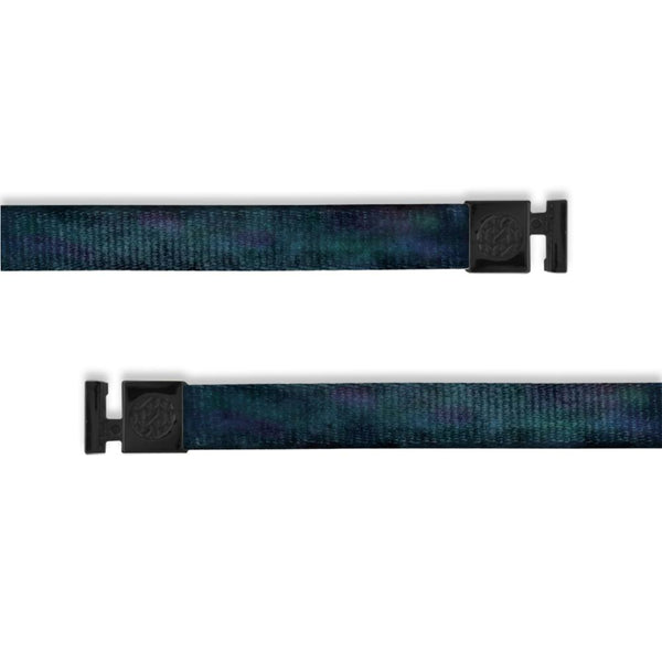 A product image of a wide and flat string with black metal aglets meant to be used with the ZOX hoodie. The string is called Milky Way. The design is a very dark blue and black watercolor to imitate the milky way galaxy