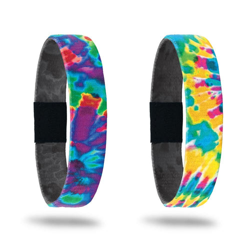 Product photo of the peace single with a purple, blue, green, and red tie dye outside design and the happiness single with a yellow, blue, orange, pink, and green tie dye outside design