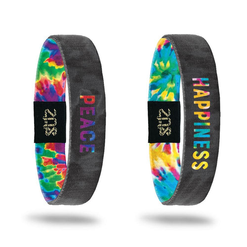 Product photo of the peace single with bold tie dye text peace overlaying a greyscale tie dye and the happiness single with bold tie dye text peace overlaying a greyscale tie dye