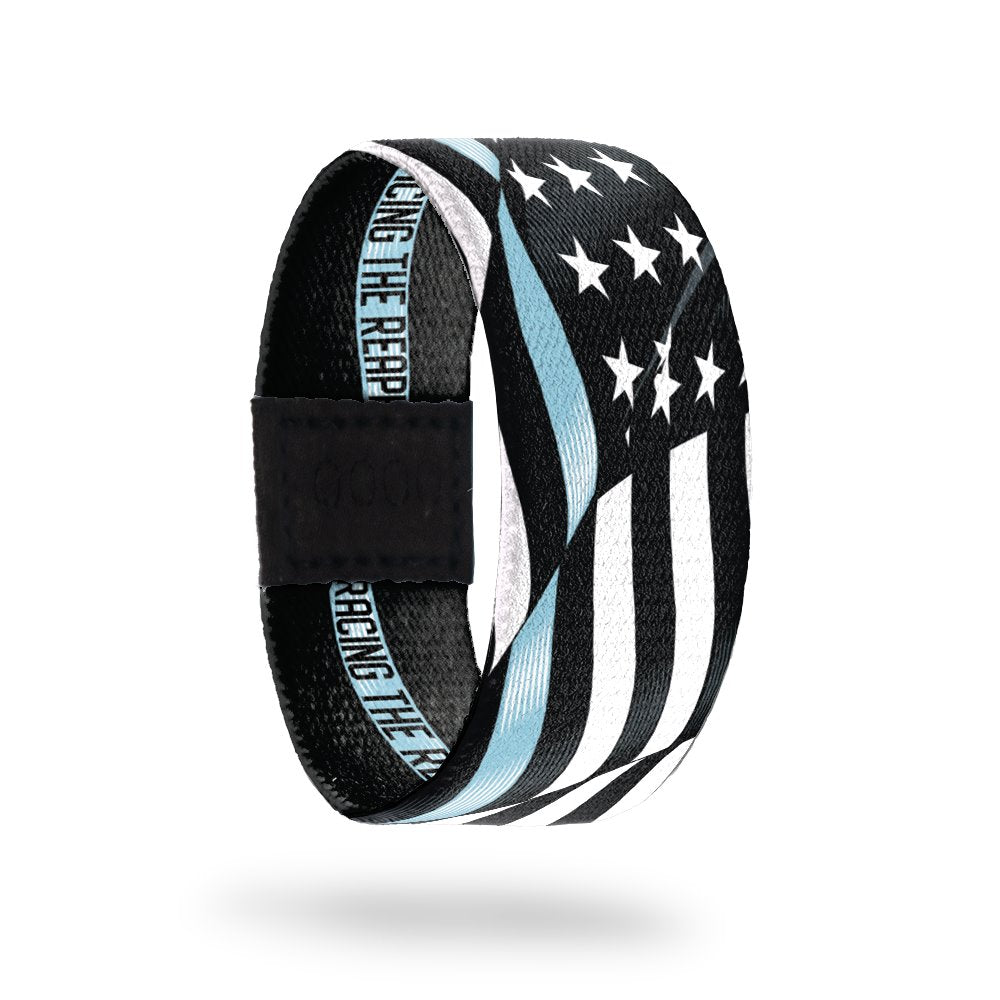Outside Design of Racing The Reaper. A wavy black and white United States flag with a line of light blue for one bottom stripe of the flag