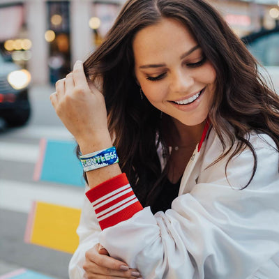 Lifestyle image of a Relentless on wrist of smiling model