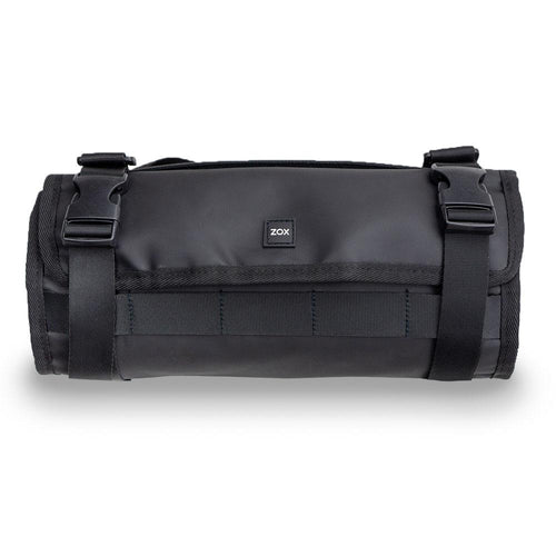 Product image of a roll capsule fully rolled up and buckled. Is great for a variety of items